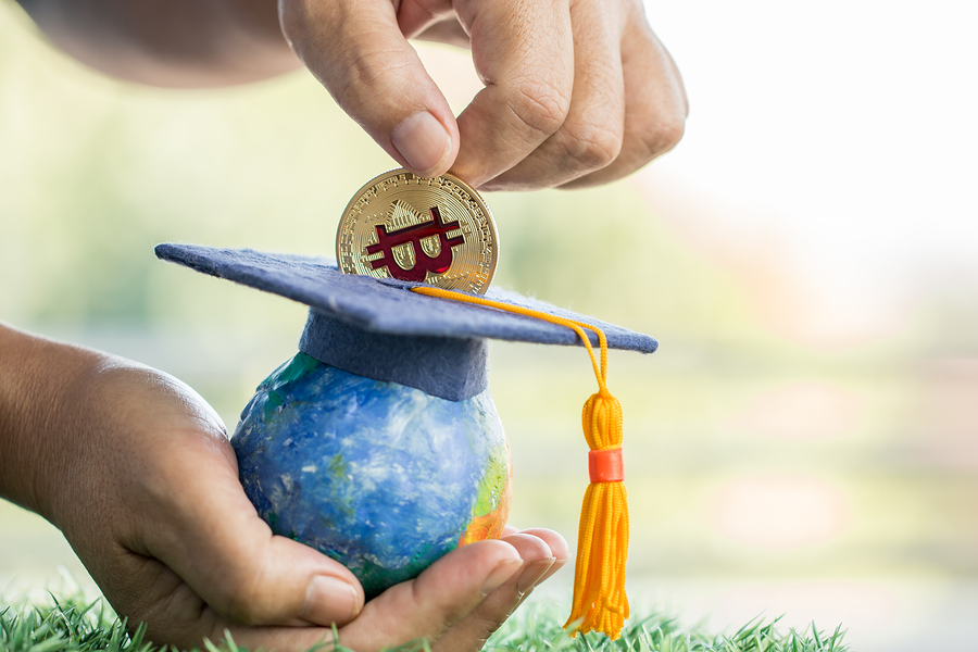 Student Hand Dropping Investing Bitcoin Money Coin To Graduation